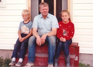 My little brother, dad, and me. Don't be jealous of the awesome sweater or the rad cowboy boots. I was eight or nine here.